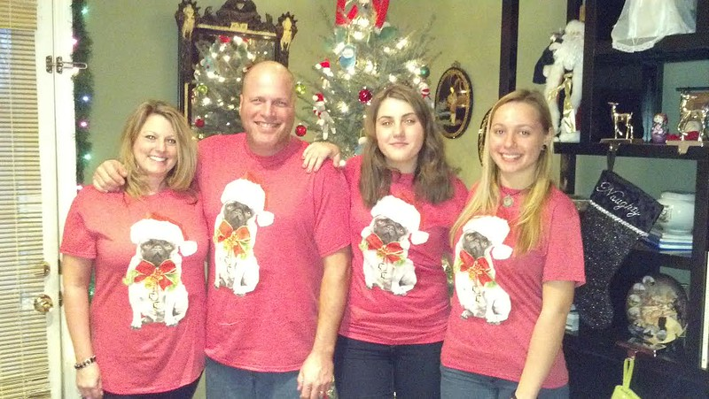 Alina from Russia, Lucia from Italy and their host parents don their cute pug Christmas-wear for the holidays in Tennessee.