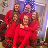 Jana from Germany and her host family in Minnesota show off their matching Christmas pajamas.