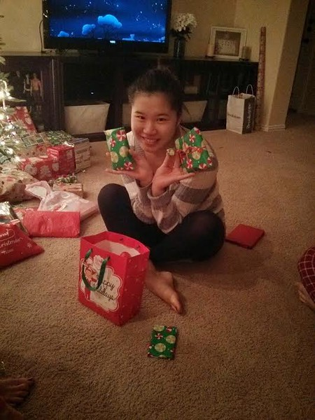 Tsukino from Japan opens presents on Christmas with her host family in Texas.