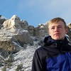 Lasse from Denmark on a family vacation at Mount Rushmore from his host home in Minnesota.