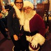 Johanna from Germany takes her first picture with Santa Claus in California.
