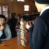 Danh from Germany and Jason from Hong Kong play a game of Jenga together in Wisconsin.