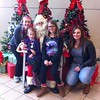 Jana from Germany meets Santa with her host family during the holidays in Wisconsin.