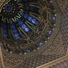 The Mausoleum was designed by Vietnamese architect Vo Toan. The dome is 12 sided with painted mahogany muqarnas (stalactites). The stained glass is from St. Gobain in France.