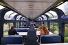 """This is the observation and club car for the Amtrak """"Empire Builder"""" passenger train. It is light and airy, you can get snacks, beer, wine or soda. Down below this is a snack bar with more tables but not as nice an observation area."""