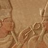 Magnificent bas relief of the god amun makes the gift of life (ankh) to the pharaoh Thutmoses IV.  Sculpted in red quartzite, with traces of the original paint remaining