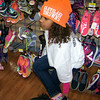 Carol Harper/charper@morningjournal.com<br /> <br /> A girl tries on shoes while wearing a Cleveland Browns beanie during Shop with a Jock at Walmart in Lorain.