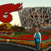 Kitty enjoys the morning walk to the Bird's Nest Olympic Stadium surrounded by so many colorful; flowers!