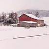 Red Barn in Spring Snow with Corn Crib
