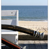 Shot at Rehoboth Beach, Delaware on a warm autumn day. These hoses are connected to some massive machinery off camera. Apparently, the beach is undergoing a restoration project. A partial view proved more interesting than capturing the entire bench.