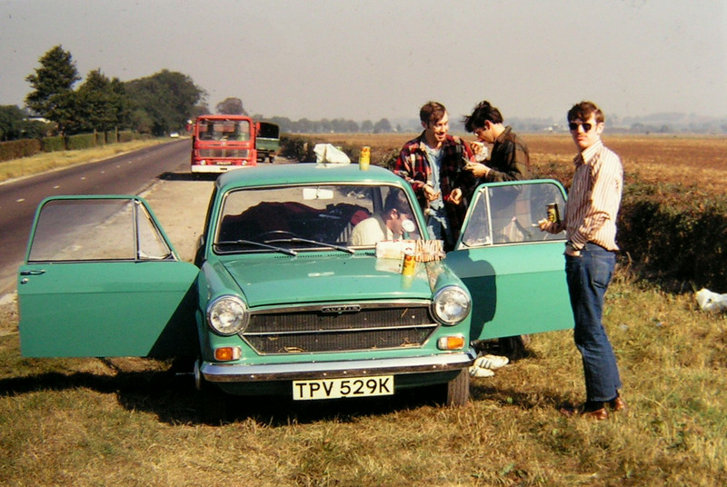 Stonehenge Trip, on the road  in car Pat Colby, Paul Stumer, dk brn shirt, and 2 unk 1972
