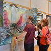 Pam Murphy, right, with her daughter Rachel Murphy, 17, center, and Calvin Bollschweiler, 17, look at artist David Griffin's painting Raigo on display in the lobby of the Audi on Saturday.<br /> <br /> February 2, 2013<br /> staff photo/ David R. Jennings