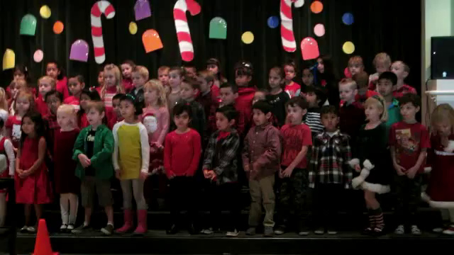 """Video of """"Let There Be Peace On Earth"""" with the kids signing the words.  Ashley is in the middle of the second row."""