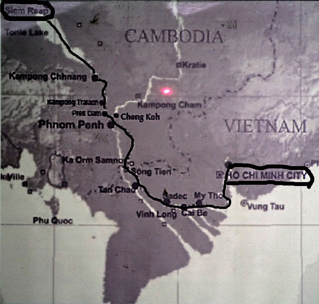 PLOTTING OUR CRUISE ON THE MEKONG.