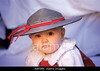 Fig 2.48 / Very Cute Italian baby<br /> <br /> Choice 6 of 13<br /> <br /> A8PJMK Baby 3-8 months sporting stylish hat and dress