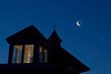Venus,crescent moon showing earthshine, & silhouetted house during eastern predawn sky