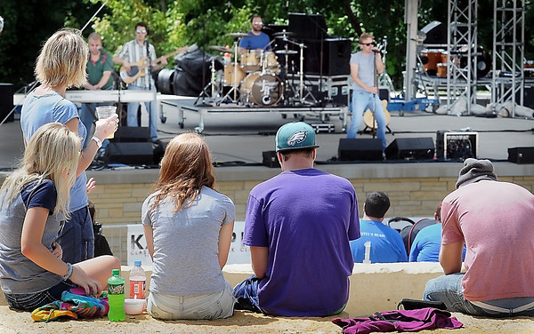 John Cross Ribfest attendees listen to live music in the Riverfront Park Amphitheather.