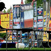 John Cross A worker is silhouetted against a colorful backdrop of barbeque company facades as he arranges tables in a tent for Ribfest. The annual event begins today at Riverfront Park and contines through Sunday.