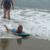 Added 8-10:  Ashley with the boogie board in the ocean the first day