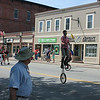 Unicyclists made their way down the street in front of the Ayer Youth Baseball and Softball group.
