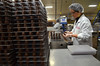 Hyeson Yang prepares chocolate covered cherries for packaging at Asher's Chocolates.   (The Reporter/Geoff Patton)