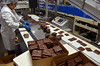 Chocolate covered crackers are packaged in a  production area at Asher's Chocolates.   (The Reporter/Geoff Patton)