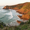 Whites Beach, and Jews Point, Broken Head Nature Reserve. Golden light of sunrise.