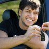 happy man showing keys in car