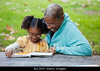TA14.25 / The photo of the African American grandmother dancing with her grandchildren is not available. The photographer is on the do not use list. We used #11 in LSD 14e. I've included some other options as well.  Choice 6 of 14  BJCJW9 African American grandmother and granddaughter reading a book