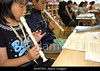 TA16.10 / The pick-up of children in Kindergarten in Japan (around the piano) is on the do not use list.  I found some that I hope might work as a possible replacement. If not, please let me know and I'll do some more research.  Choice  7 of 14  AW6T8W Japanese elementary students playing recorders