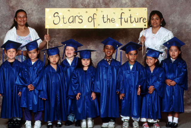 TA16.9   Can you confirm this one.  From your permissions log, I believe you would rather use this photo.  However, the VAM had option #2 shown.  Choice 1 of 2, Pick-up from Child Development 12e page 481  --- Preschool graduation --- Image by © Ronnie Kaufman/CORBIS