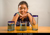 Fig 6.8 / Piaget's Conservation Task.  Choice 5 of 8  CX4KJF A child looks at identical glasses filled with the same amount of liquid to demonstrate Piaget's Liquid Conservation experiment.