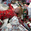 Video of Ashley making a snow angel in wrapping paper pile