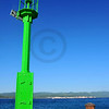 a green beacon to alert shipping at the entrance to a port in the mediterranean