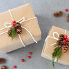Different types of Christmas wrapping decorated with nature pine cones aranged in a photo.