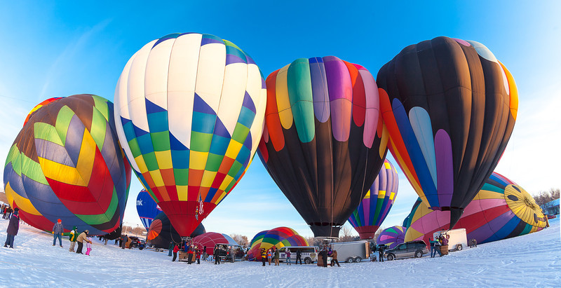 08DEC2013  Five Below Flight  For the V challenge today……a vehicle.  From the Hudson Hot Air Affair last year in Hudson Wisconsin, so cold my tripod would not move left or right or up or down.  Thanks for all the wonderful comments, they help me get better!