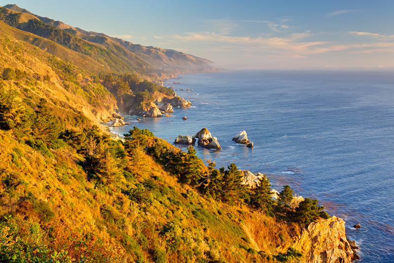 """Big Sur Coastline at Sunset"" Printing a 30x40 of this for a collector and thought I would share! Driving along Highway 1 down to Big Sur gives some breathtaking vistas!! Make sure you pull off at every spot as the coastline continues to change. If you look down at the waterline there is a arch that the water flows through. Winter days lets you get nice clear views without the fogs and are one of my favorite times to go - especially with crazy war weather we are having this January in Northern California. Love the amazing hills, rocks and trees down to the ocean. This can be made into a 1:2 and 1:3 ratio Panorama which looks fantastic on your walls above the couch, fireplace or in a conference room or office! Let me know if you like it!<br /> — in Big Sur, CA."