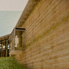 Another view, by Bahr Vermeer Haecker architects, of the rammed earth wall on the west side of the Chadron State College Rangeland Complex Phase II, featuring a glassed-in walk-through.
