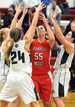 Pat Christman Manakto West's Lauren Resner draws a crowd of Faribault defenders during the second half Friday at the West gym.