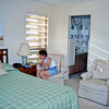 Judy Hilburger in bedroom of Harbourside Condominium at South Pasadena, FL