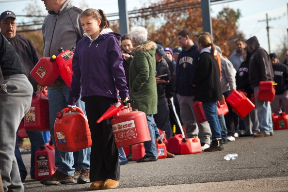Hurricane Sandy Photo for Chapter 1  Choice 4 of 17  HAZLET TOWNSHIP, NJ - NOVEMBER 01:  A girl holds jerry cans while waiting in line at a gas station on November 1, 2012 in Hazlet township, New Jersey. United States. Superstorm Sandy, which has left millions without power or water, continues to effect business and daily life throughout much of the eastern seaboard.  (Photo by Andrew Burton/Getty Images)