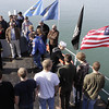 Shaun Walker/The Times-Standard<br /> <br /> Retired Navy veterans, family, and friends of eight new U.S. Navy recruits filled the upper deck of the World War II Landing Craft Infantry 1091 on the Eureka waterfront Friday.