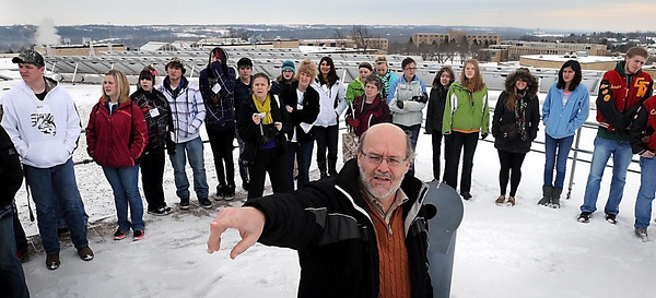 John Cross Gustavus Adolphus professor Jim Dontje points out some of the energy-saving devices installed on the roof of GAC's Olin Hall to area high school students participating in a Youth Energy Summit on Tuesday. Students visited several area facilities to view green features and alternative energy sources.