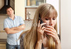 M167, TA7.8: person talking on cell phone, with someone standing close by who appears to be eavesdropping Choice 3 of 9  Wife confer privately on the phone