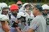 Assistant coach Mark Pasquale speaks with players at Pennridge football practice.   Tuesday,  August 12, 2014.    Photo by Geoff Patton