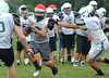 Austin Herlinger advances during Pennridge High School footall practice.    Tuesday, August 12, 2014.   Photo by Geoff Patton