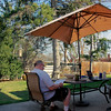 2012  - Mark reading in backyard patio at the house