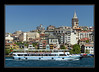 The Golden Horn with tour boat and Galata Tower...