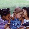 SO3 / Choice 12 of 13 /  Friends with a children's book --- Image by © Tom & Dee Ann McCarthy/CORBIS