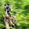 John Cross The forest passes by in a blur a zip-line rider at Kerfoot Canopy Tour located between Henderson and Blakesley